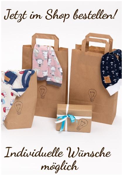 Individuell gestaltete Kleidung in Tüten