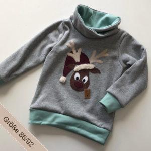 Handgemachter Pullover mitt Rentierapplikation