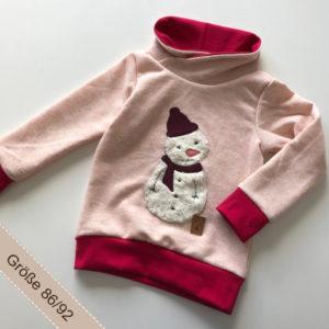 Handgemachter Pullover mit Schneemannapplikation auf Rosa